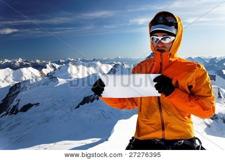 Alpinist on Monch Peak with sponsor flag, Berner Oberland, Switzerland - UNESCO Heritage - with space for text