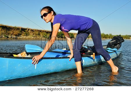 Young girl pulling a canoe