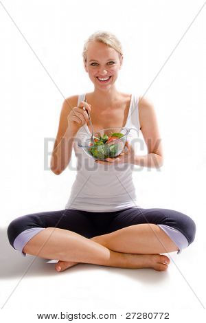 young girl eating a healthy salad,