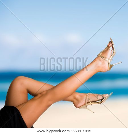 woman on the beach with sexy legs