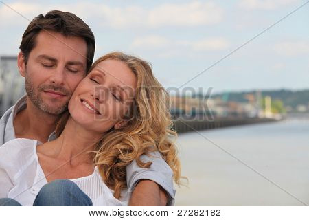 Couple in a loving embrace on the waterfront of Bordeaux