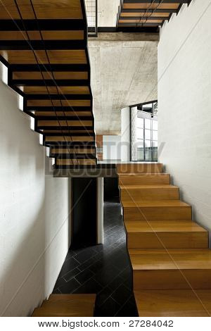 interior modern villa, room  fireplace and wooden staircase