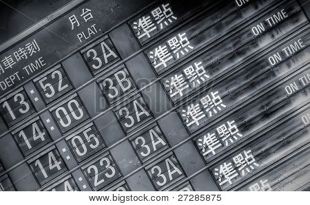 "Railroad timetable wrote "" On Time"" in Taipei."