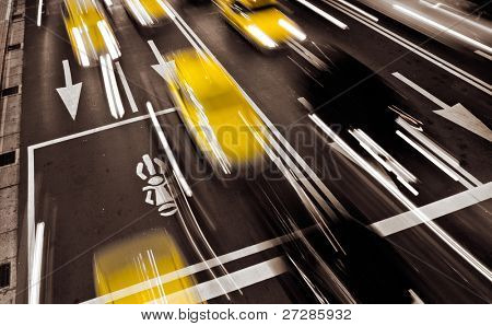 Taxi in modern city with motion blurred.