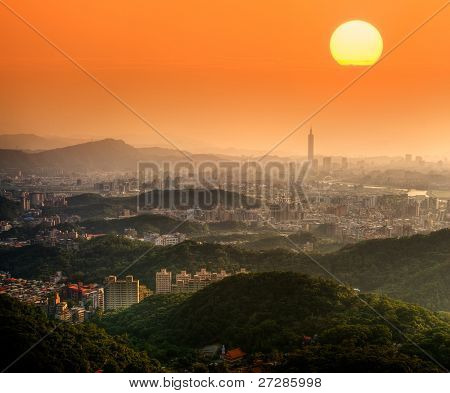 Taipei sunset with beautiful sun and buildings and famous skyscraper in Taiwan.