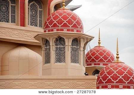 Architecture of mosque with red doom of roof.