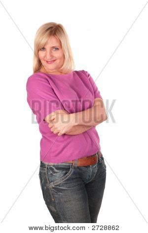 Middleaged Woman In Pink Shirt Stands Posing