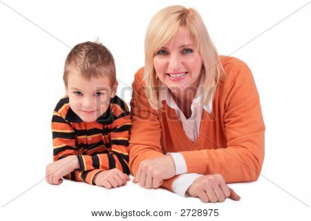 Middleaged Woman With Boy Lying