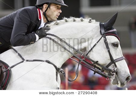 BUDAPEST, HUNGARY - DECEMBER 3: An unidentified competitor jumps with his horse at the OTP Equitation World Cup, December 3, 2011 in Budapest, Hungary