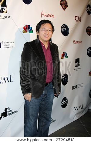 LOS ANGELES - DEC 7:  Masi Oka arrives at the JHRT's 9th Young Hollywood Holiday Party at Eden on December 7, 2011 in Los Angeles, CA