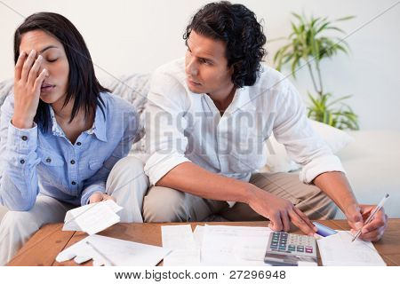 Young couple checking their bills