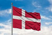 Flag Of Denmark Waving In The Wind Against White Cloudy Blue Sky. Danish Flag. poster