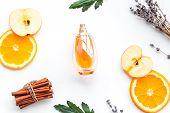 Sweet Perfume With Fruit Fragrance. Bottle  Of Perfume Near Apple, Orange, Lavender, Cinnamon On Whi poster