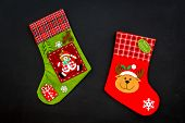 Christmas Socks. Traditional Decorative Socks For Small Gifts On Black Background Top View poster