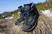 foto of welts  - Pair of tourists boots on dry grass - JPG