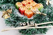 Christmas Sushi. New Year Sushi. Sushi And Christmas Wreath And The Word Sushi. Front View. poster