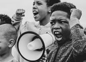 Young boy shouting on a megaphone in a protest poster