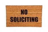 stock photo of soliciting  - A no soliciting doormat isolated on a white background - JPG