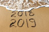 2019, 2018 Years Written On Sandy Beach Sea. Wave Washes Away 2018. poster