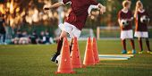 Football Drills: The Slalom Drill. Youth Soccer Practice Drills. Young Football Players Training On  poster