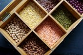 A Box Of Different Indian Legumes Or Pulses. poster