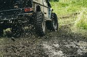 Leading Up Through The Extreme Trails. Suv Or Offroader On Mud Road. Car Racing Offroad. Offroad Car poster