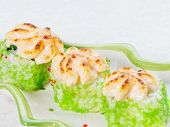 Baked Sushi With Flying Fish Roe. Green Sushi Rolls On A Light Background, Close-up. Macro Photo Of  poster