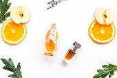 Sweet Perfume With Fruit Fragrance. Bottle  Of Perfume Near Apple, Orange, Lavender On White Backgro poster