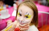 Face Painting For Cute Little Gorl During Kids Merriment. Face Paint For animals Theme On Birthday poster