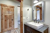 White And Fresh Bathroom Interior With A Rectangular Vessel Sink And Dark Gray Countertop. poster