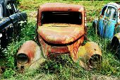 stock photo of forlorn  - Rusty old car wreck - JPG