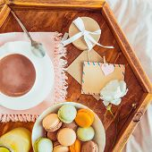 Breakfast In Bed With Empty Blank Card. Cup Of Coffee, Juice, Macaroons, Flower And Giftbox On Woode poster