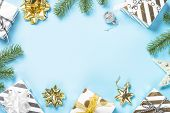 Christmas Flatlay Background. Silver And Gold Christmas Decorations And Present Box On Blue Backgrou poster