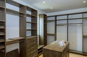 Bedroom Closet With Storage Bins And Shelves Large Wardrobe Closet, With Empty Shelves. poster