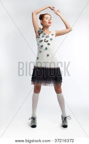 Sensual Redheadr Female In Stylish Dress Posing