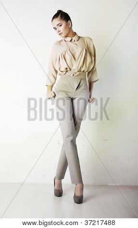 Fashion Girl In White Trousers And Blouse Posing