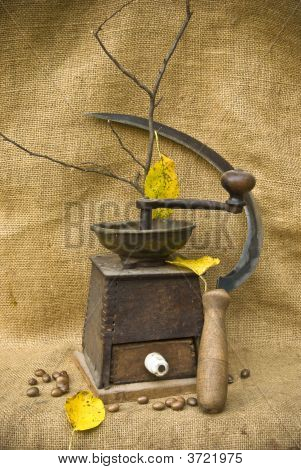 Coffee Mill With Beans And A Sickle
