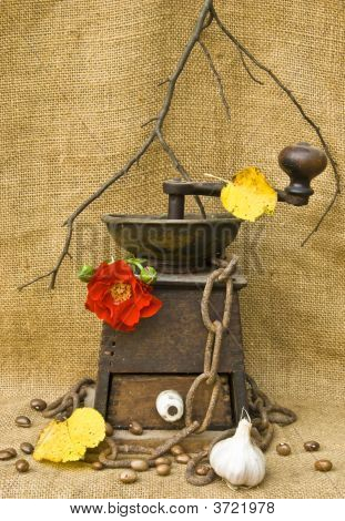 Coffee Mill With Beans Garlic And A Rose