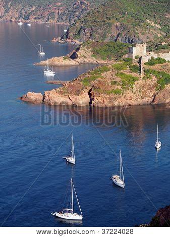 Sailboat and Girolata Genovese Fort , Corsica , France