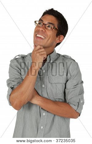 College age man looking up to the left with hand on his chin
