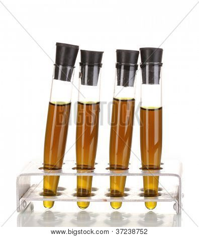Test-tubes with brown liquid isolated on white