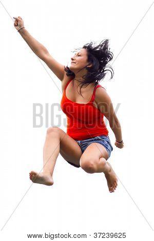 Brunette jumping on trampoline over white background