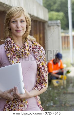 Casual businesswoman carrying laptop