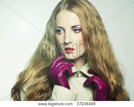 Portrait Of Young Beautiful Woman In Purple Gloves