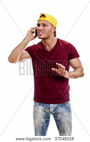 Cool Handsome Guy Talking On The Mobile Phone. Isolated On White