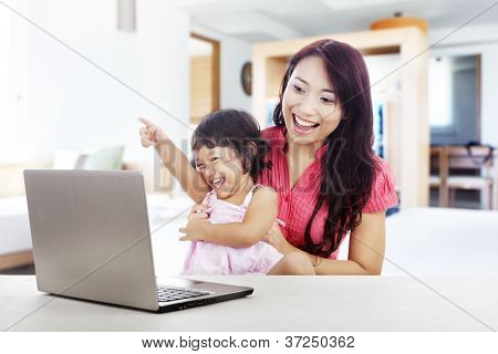 Cheerful Family With Laptop Computer