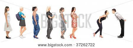 Women waiting in line to kiss a guy isolated on white background