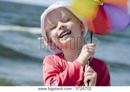 Cheerful Little Girl With Pinwheel
