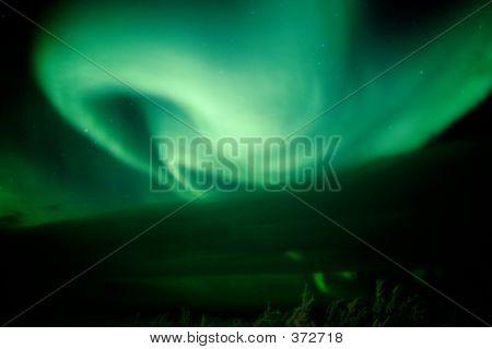 Aurora Swirl Growing From Behind Cloud