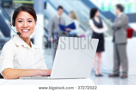 Call center operator business woman with laptop computer.